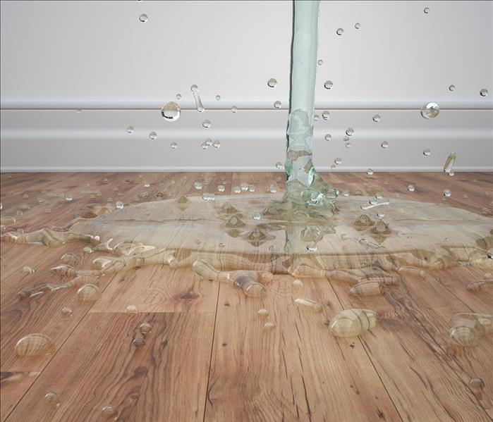 Water falling on wooden floor